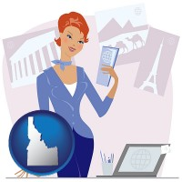 idaho a travel agent in a travel agency, holding airline tickets